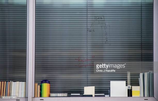 Writing is seen on the window of the floor occupied by company Cambridge Analytica on March 21 2018 in London England UK authorities are currently...