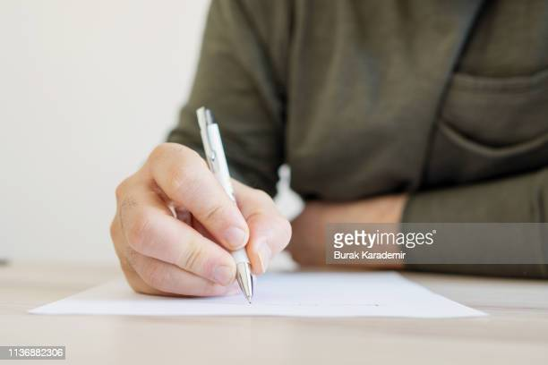 writing letter - writing stock pictures, royalty-free photos & images