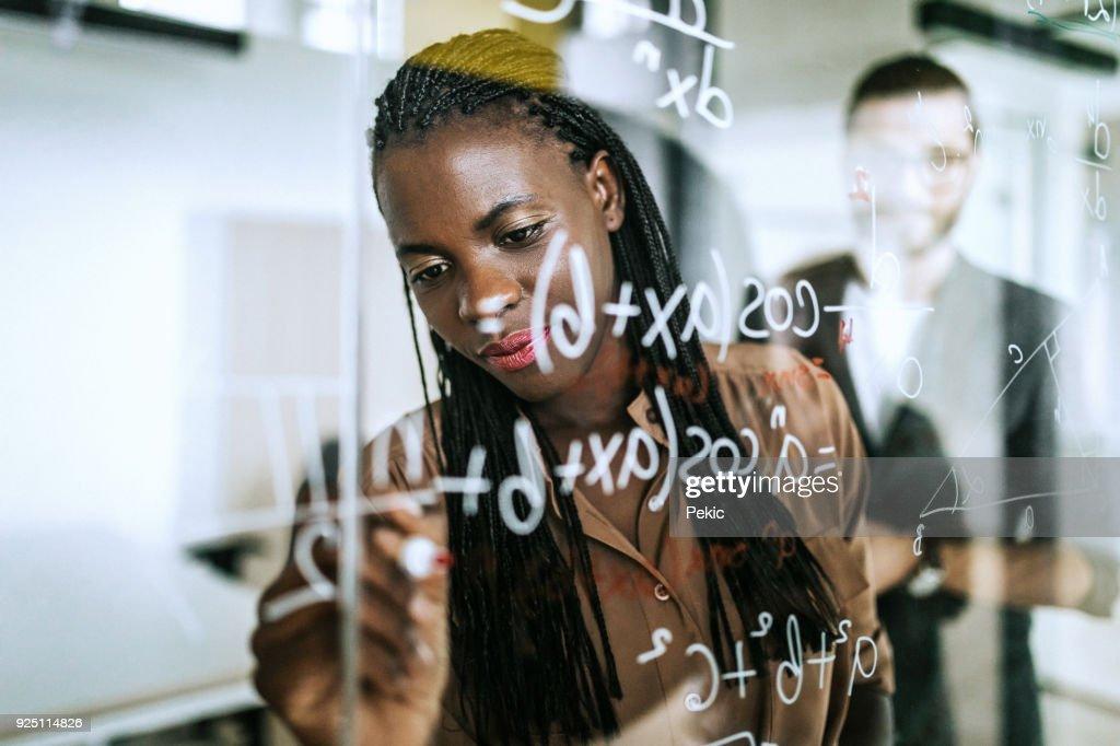 Writing Mathematical Formulas On Transparent Wipe Board : Stock Photo