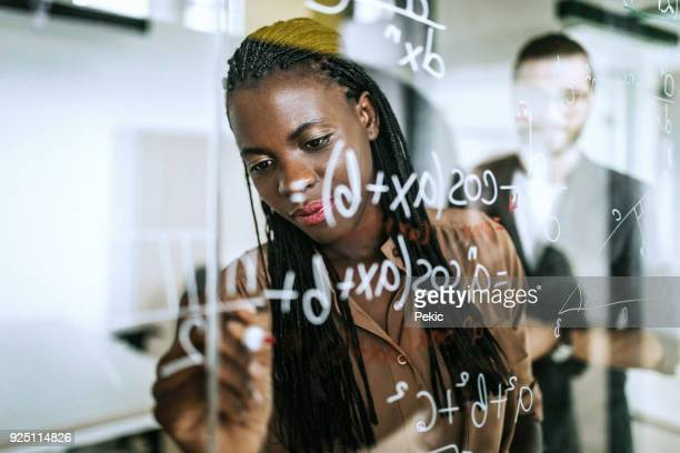 Writing Mathematical Formulas On Transparent Wipe Board