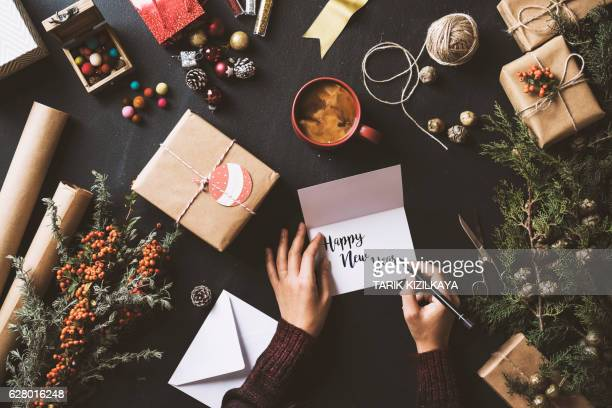 writing new year cards, table top flat lay - greeting card bildbanksfoton och bilder