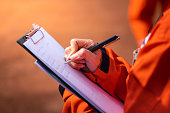 Writing note on paper - Audit and inspection in oil field operation.
