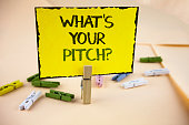 Writing note showing  What Is Your Pitch Question. Business photo showcasing Present proposal Introducing Project or Product written on Yellow Sticky Note Paper on plain background Wooden Clips.