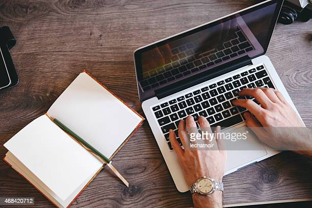 writing on a laptop - authors stock pictures, royalty-free photos & images