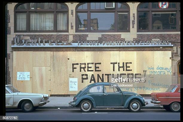 Writing on boardedup store fronts reading FREE THE PANTHERS