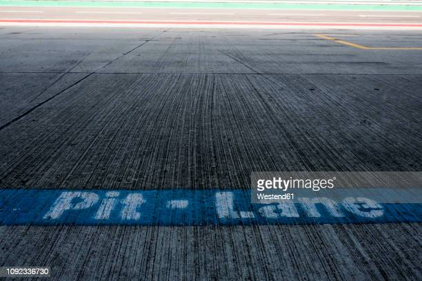 writing pit lane on racetrack - pit stop stock pictures, royalty-free photos & images