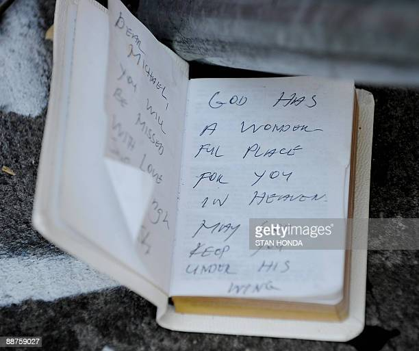 Writings in a diary at a wall where people have left condolences for pop star Michael Jackson June 30 2009 at the Apollo Theater in the Harlem...