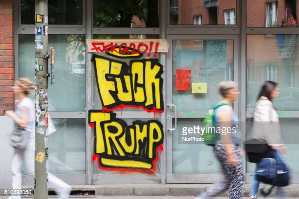 Writings on windows of a shop reading 'Fuck Trump' are pictured during the G20 Summit in Hamburg Germany on July 8 2017