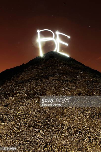 'BE' written in light on the top of hill