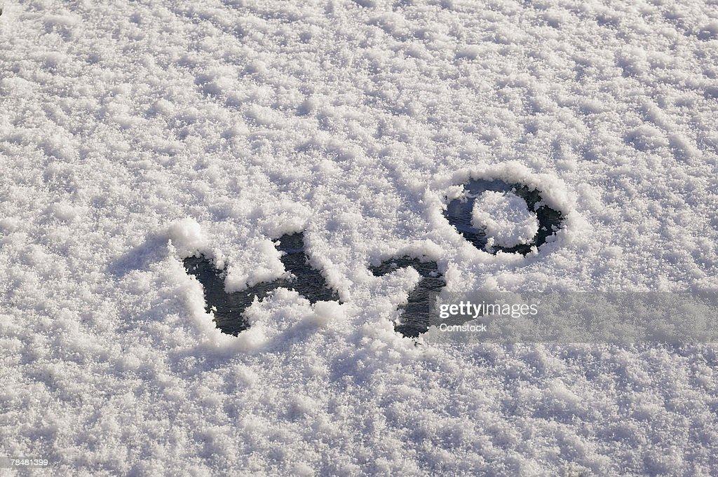 H2O written in snow : Stock Photo