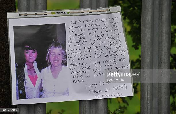 A written message and picture of murdered teacher Anne Maguire is left as a tribute outside Corpus Christi Catholic College in Leeds northern england...