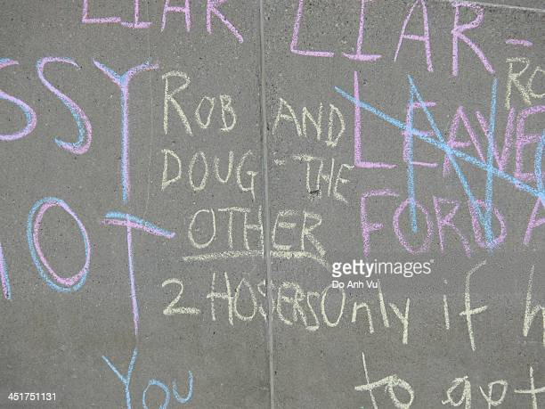 CONTENT] Written on a wall of a pedestrian bridge in front of Toronto's City Hall Rob Ford and his brother Doug are being labeled as the other 2...