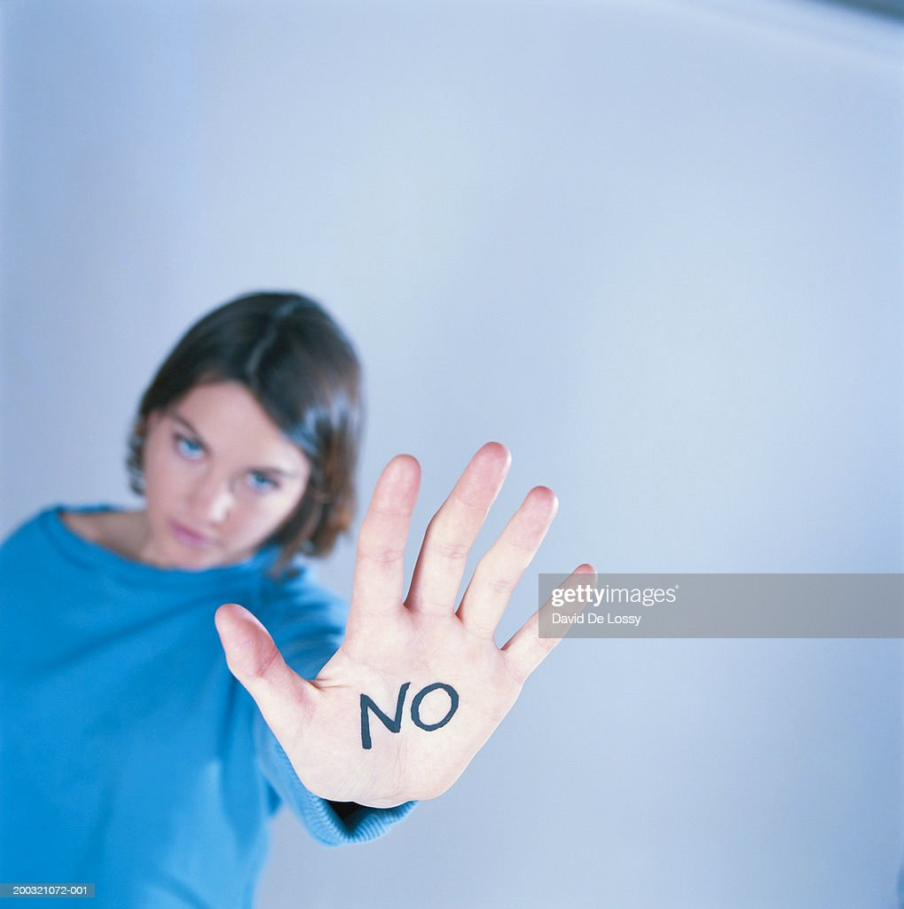 'NO' written on palm of young woman (focus on palm) : ストックフォト