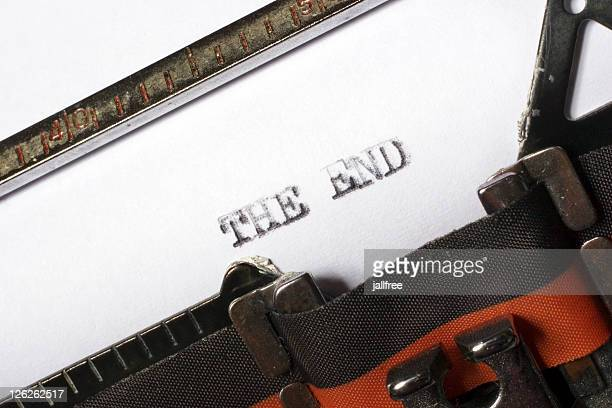 the end written or typed oton old typewriter - publisher stock pictures, royalty-free photos & images