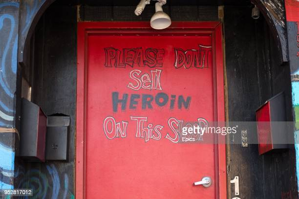 A written sign on a red door front in Staten Island reads 'please don't sell heroin on this stoop' Staten Island has faced an increase in heroin and...