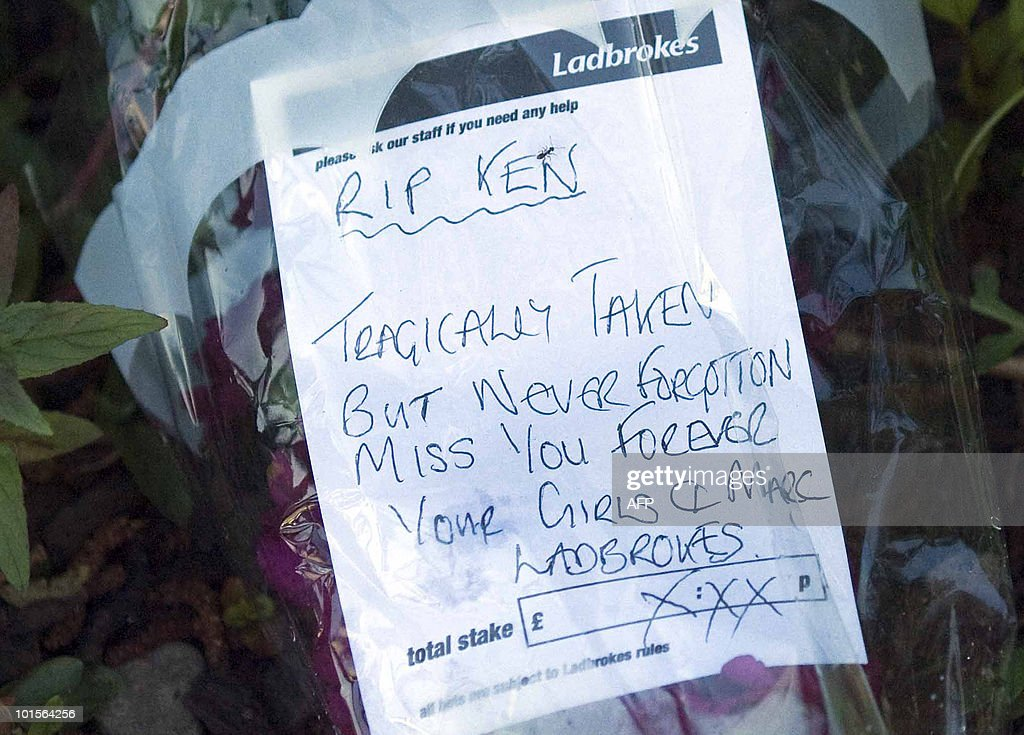 A written tribute is pictured on a betting slip left with flowers at the scene of a shooting on the Old Bridge, in Egremont, Cumbria, north-west England on June 2, 2010. A gunman killed at least 12 people in a deadly rampage through a popular tourist region in northwest England Wednesday, before apparently turning the gun on himself, police said. Some 25 people were injured, three critically, when 52-year-old taxi driver Derrick Bird spent over three hours driving through the Lake District, reportedly shooting at people from his car window. AFP PHOTO/Derek Blair