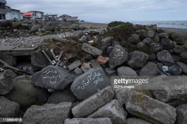 Written warnings on rocks about the risk of disease and the prohibition of swimming around the sewage pipe on the coastline at the wind park sewage...