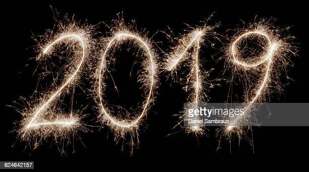 2019 written with a sparkler - 2019 stock pictures, royalty-free photos & images