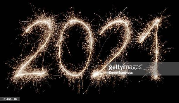 2021 written with a sparkler - daniel funke stock-fotos und bilder
