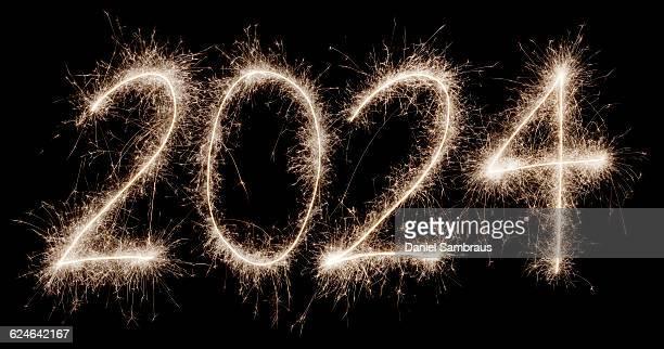 2024 written with a sparkler - daniel funke stock-fotos und bilder