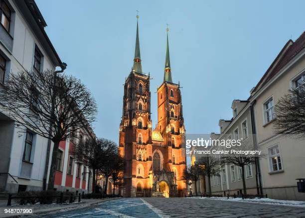 wroclaw cathedral facade illuminated at late dusk in wroclaw, silesia, poland - john the baptist stock photos and pictures