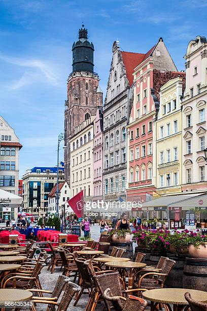 Wroclaw's lively Old Town market square or Rynek surrounded by outdoor restaurants and medieval houses