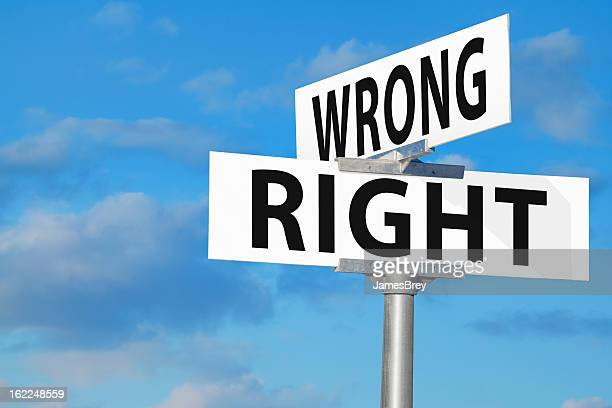 wrong versus right street sign - morality stock pictures, royalty-free photos & images