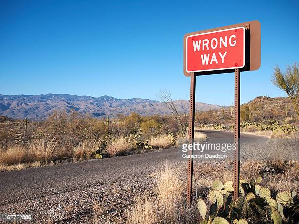wrong way road sign - wrong way stock pictures, royalty-free photos & images