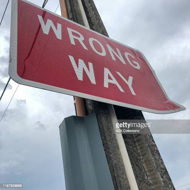 wrong way sign board - wrong way stock pictures, royalty-free photos & images