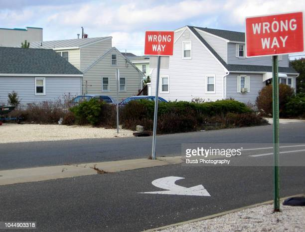 wrong way signs in a street in surf city, new jersey, usa - wrong way stock pictures, royalty-free photos & images