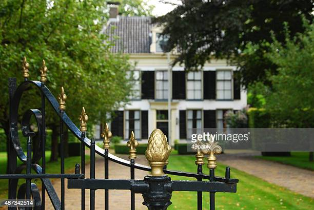 Wrought Iron fence infront of a semi detached house.