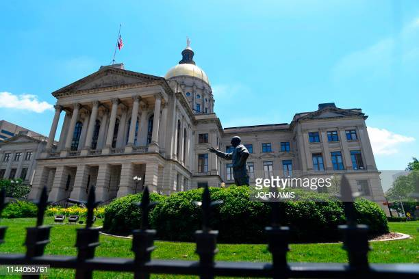 Wrought iron fence surrounds the Georgia State Capitol as a statue of former Governor, State House Representative and US Senator Richard B. Russell...