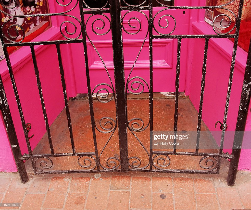 Wrought Iron gate and Pink Doorway : Stock Photo