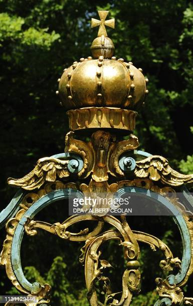 Wrought iron gate at the entrance to the Schwetzingen castle garden detail BadenWurttemberg Germany