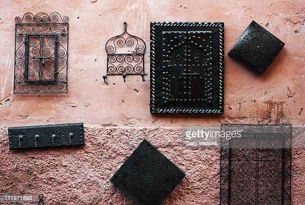 wrought iron handycraft hanging on a wall - yeowell stock pictures, royalty-free photos & images