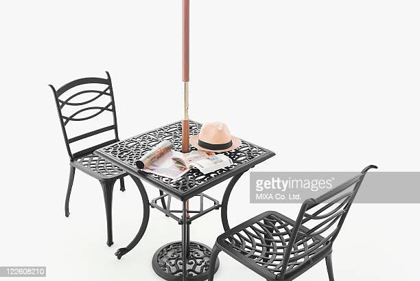 Wrought iron table and chairs with parasol