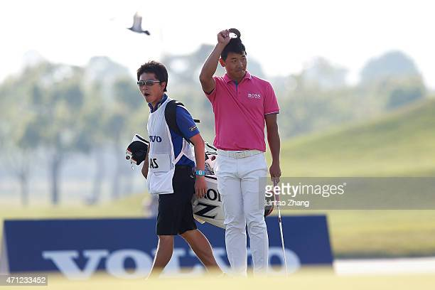 Wu Ashun of China celebrates after chipping in for an eagle during the day four of the Volvo China Open at Tomson Shanghai Pudong Golf Club on April...