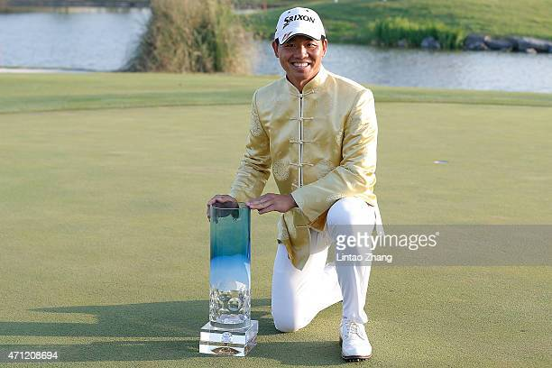 Wu Ashun of China holds the trophy after winning the Volvo China Open at Tomson Shanghai Pudong Golf Club on April 26, 2015 in Shanghai, China.