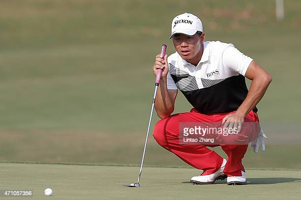 Wu Ashun of China lines up a putt during the day three of the Volvo China Open at Tomson Shanghai Pudong Golf Club on April 25 2015 in Shanghai China