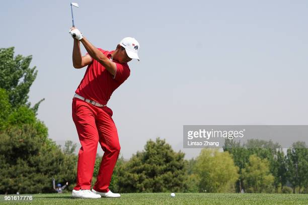 Wu ashun of China plays a shot during the day two of the 2018 Volvo China Open at Topwin Golf and Country Club on April 27, 2018 in Beijing, China.
