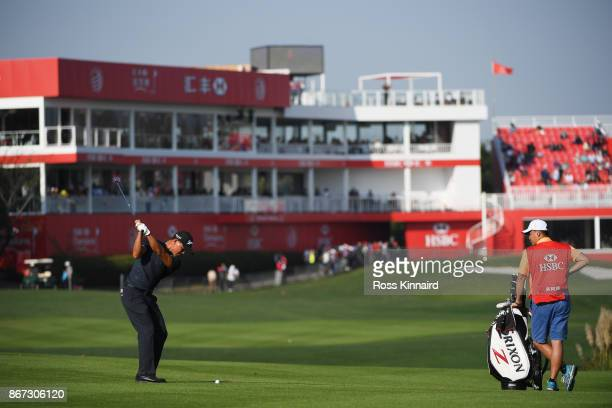 Wu Ashun of China plays a shot on the 18th hole during the third round of the WGC HSBC Champions at Sheshan International Golf Club on October 28...
