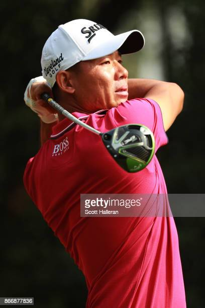 Wu Ashun of China plays his shot from the 14th tee during the second round of the WGC - HSBC Champions at Sheshan International Golf Club on October...