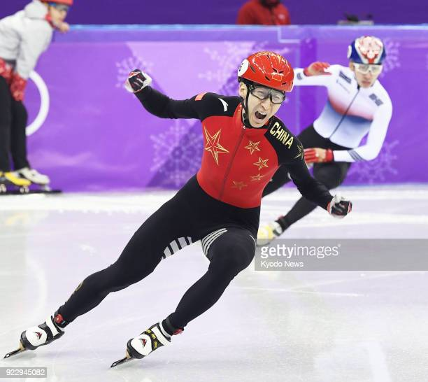 Wu Dajing of China celebrates after winning the shorttrack speed skating men's 500meter gold medal at the Pyeongchang Winter Olympics in Gangneung...