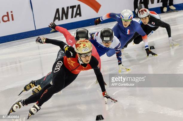 Wu Dajing of China Charles Hamelin of Canada Victor An of Russia Sebastien Lepape of France and Ryosuke Sakazume of Japan compete during the men's...