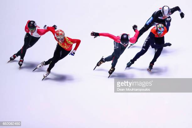 Wu Dajing of China leads and goes onto victory and his gold medal after he competes in the 1500m B Mens Final with silver medalist Daan Breeuwsma of...
