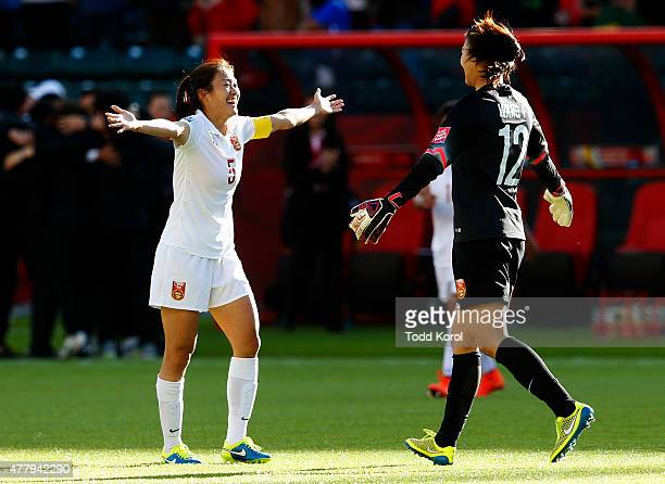 Wu Haiyan and Wang Fei of China celebrate their win over Cameroon during the FIFA Women's World Cup Canada Round 16 match between China and Cameroon...