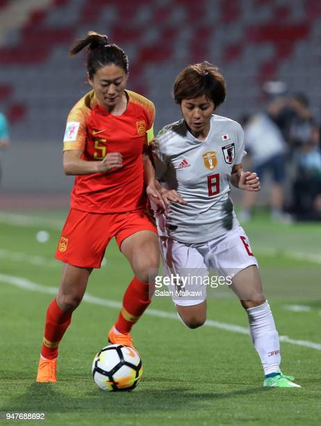Wu Haiyan of China and Mana Iwabuchi of Japan callenge for the ball during the AFC Women's Asian Cup semi final between China and Japan at the King...