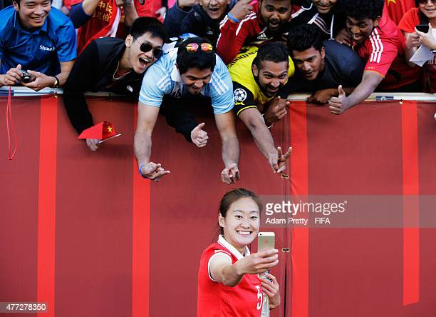 Wu Haiyan of China celebrates with fans after the FIFA Women's World Cup 2015 Group A match between China PR and New Zealand at Winnipeg Stadium on...
