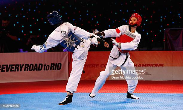Wu Jingyu of China and Chanatip Sonkham of Thailand compete in Seniors Female A 49kg Final during the World Taekwondo Grand Prix held at the...