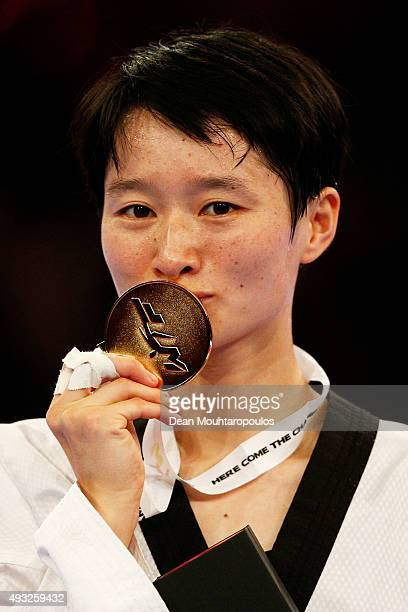 Wu Jingyu of China poses with her Gold medal after victory against Chanatip Sonkham of Thailand in Seniors Female A 49kg Final during the World...